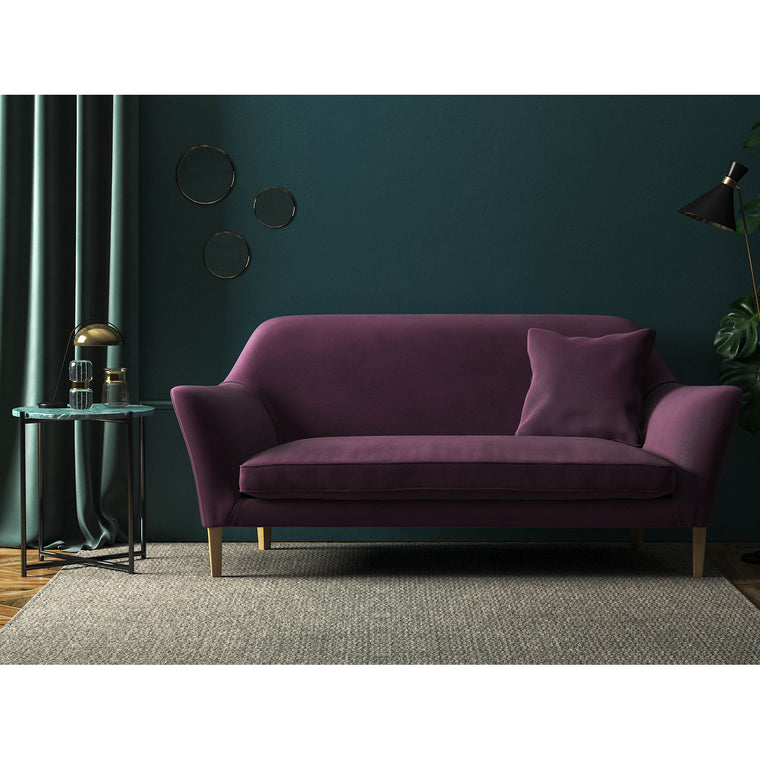Sofa in a luxury dark purple velvet upholstery fabric with a stain resistant finish