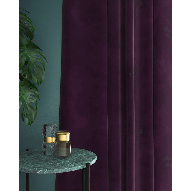Curtains in a bright purple plain velvet fabric with a stain resist finish