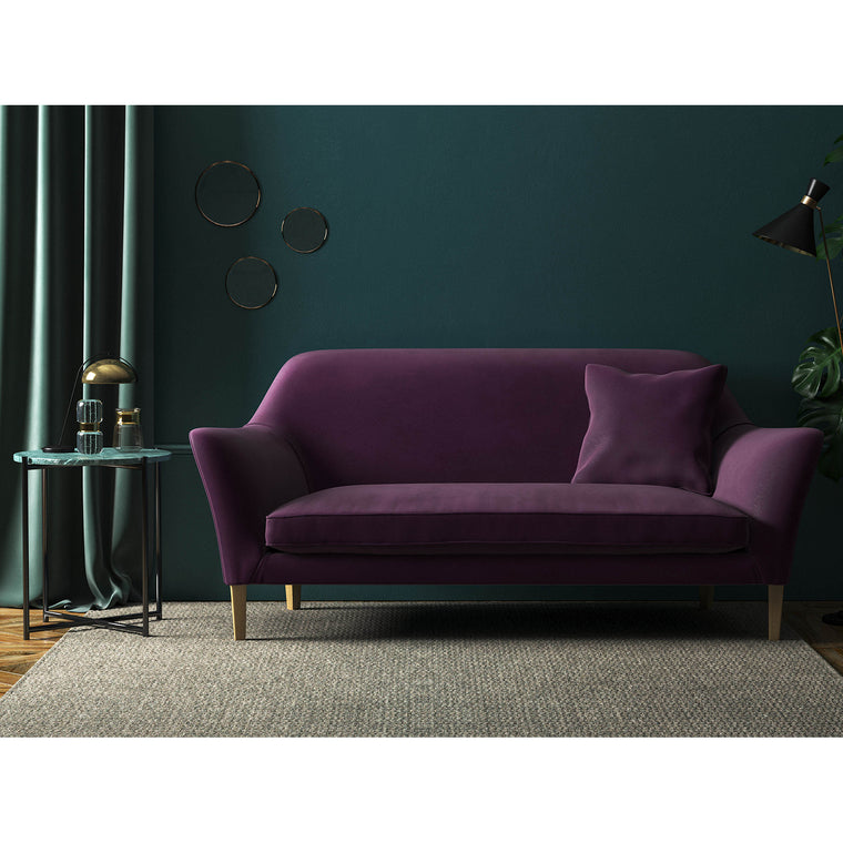 Sofa in a luxury purple velvet upholstery fabric with a stain resistant finish