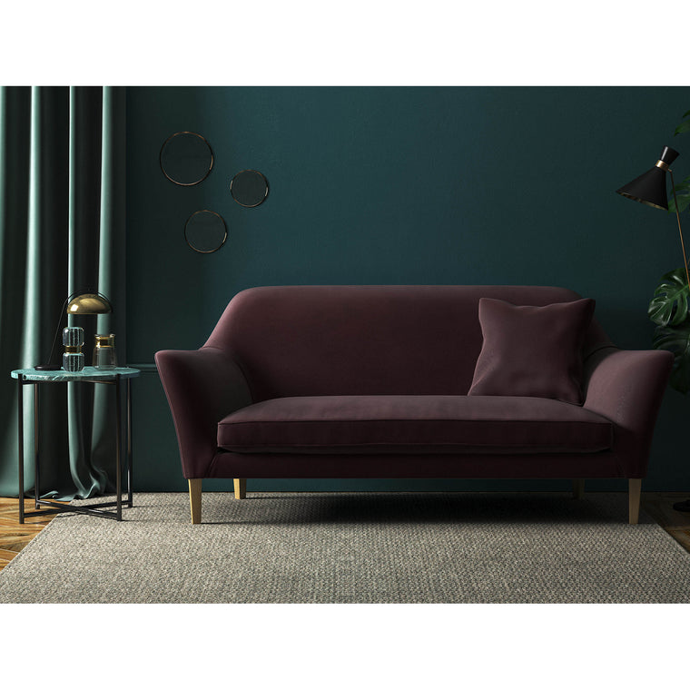 Sofa in a luxury plain dark purple velvet upholstery fabric with a stain resist finish