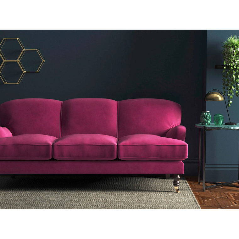 Sofa in a candy pink velvet upholstery fabric with a stain resistant finish