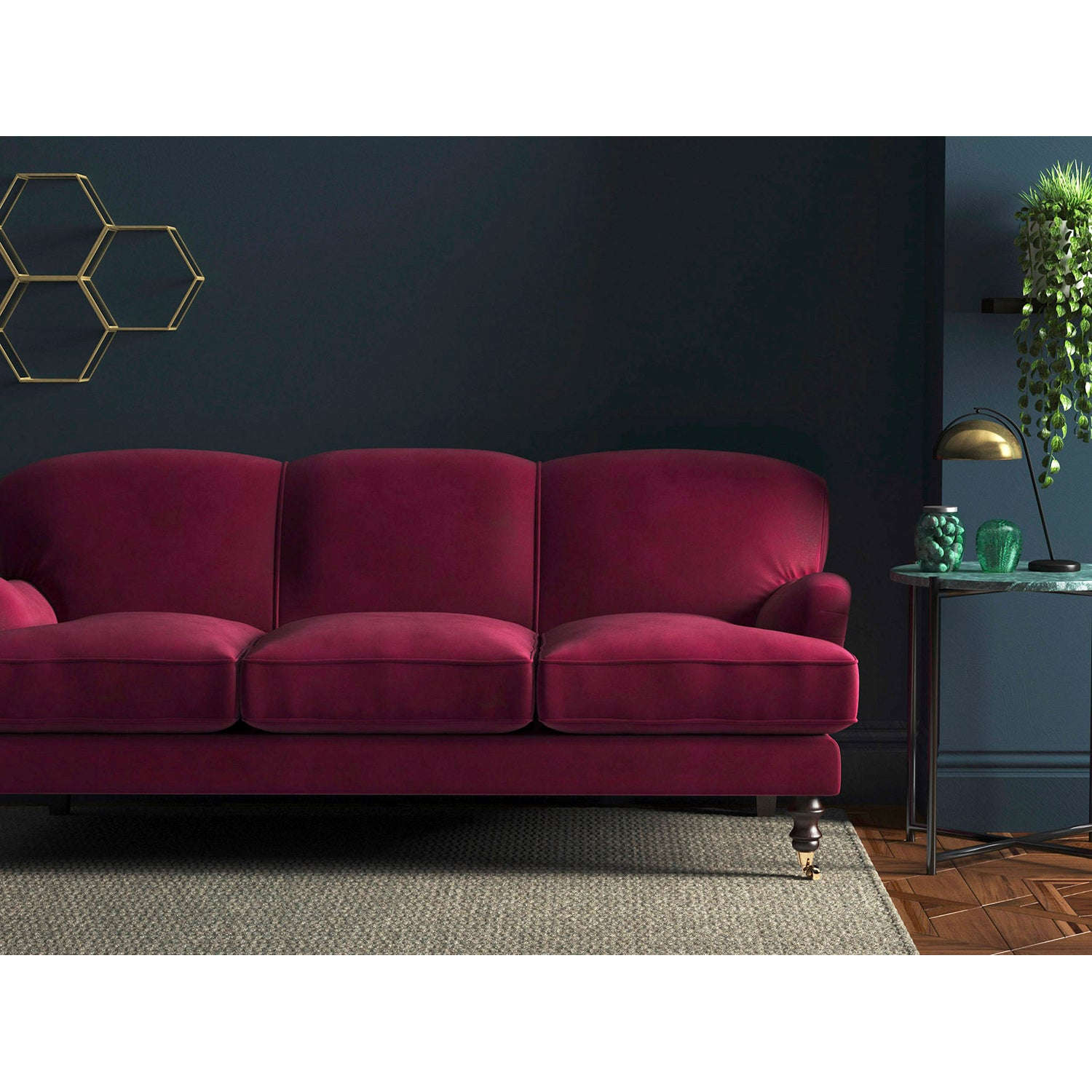Sofa in a luxury berry coloured velvet upholstery fabric with a stain resistant finish