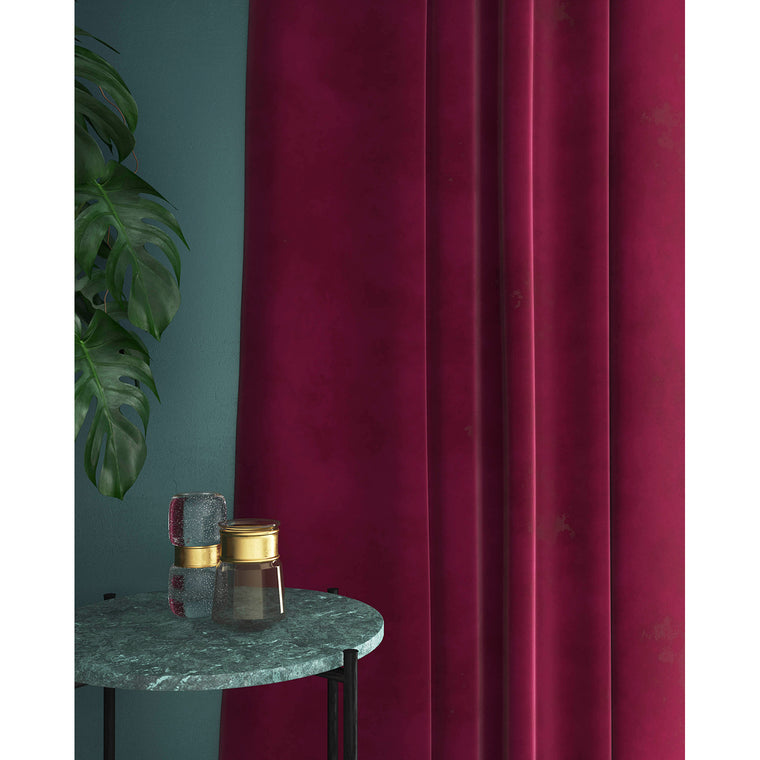 Curtains in a plain berry coloured velvet with a stain resistant finish