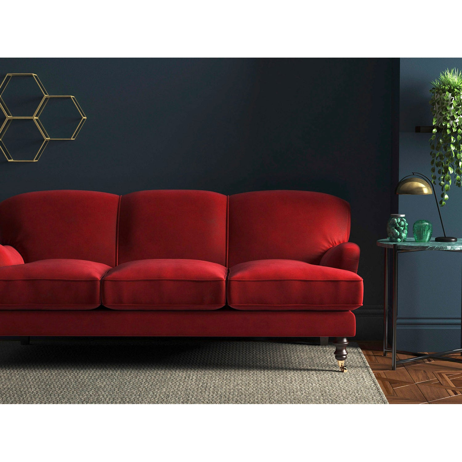Sofa in a pillarbox red velvet upholstery fabric with a stain resist finish