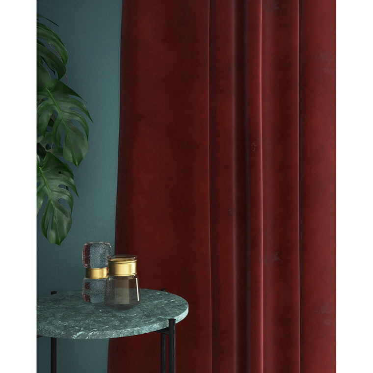 Curtains in a plain brick red velvet fabric with a stain resistant finish
