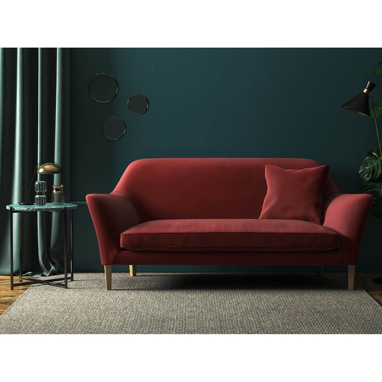 Sofa in a brick red plain velvet upholstery fabric for domestic and contract use