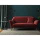 Dark red velvet sofa with a stain resistant finish