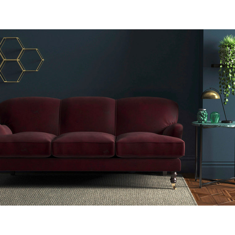 Sofa in a berry red coloured velvet upholstery fabric for contract and domestic use