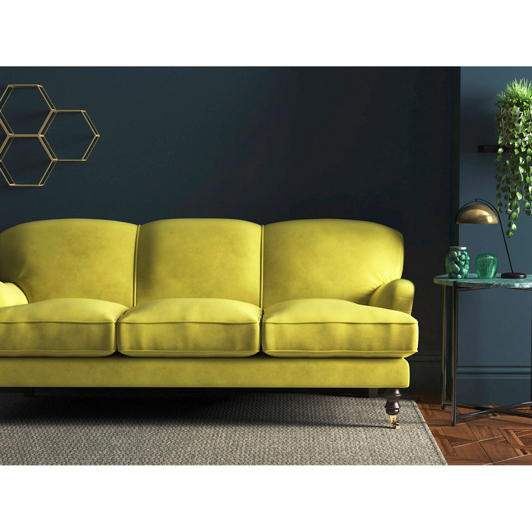 Bright yellow velvet sofa with a stain resistant finish