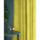 Curtains in a plain bright yellow velvet fabric with a stain resist finish
