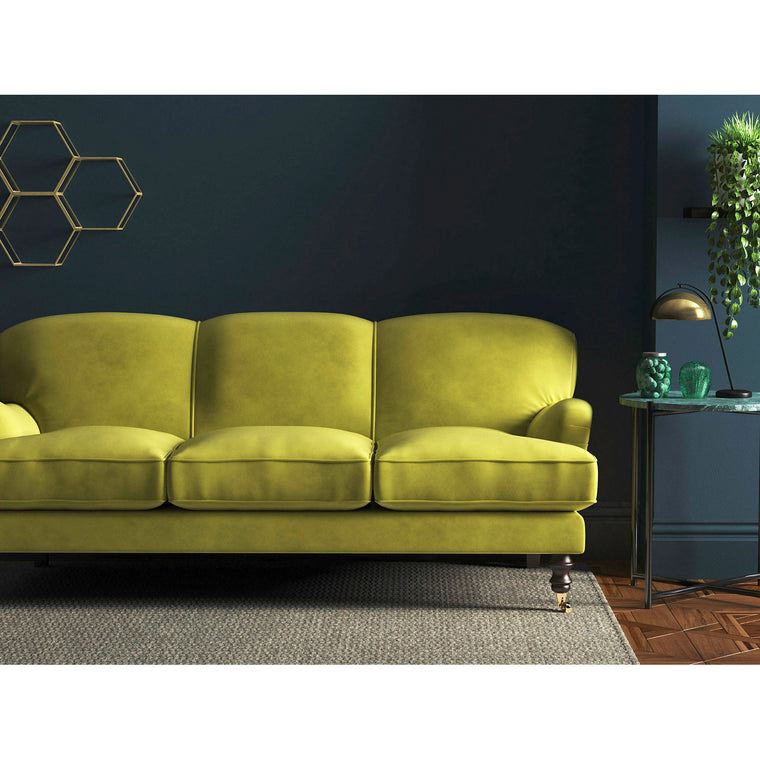 Plain yellow-green coloured sofa in a stain resistant plain upholstery velvet