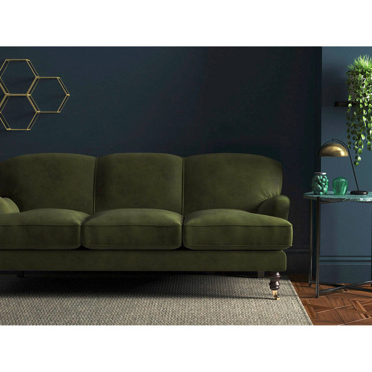Sofa in a plain dark green upholstery velvet with a stain resistant finish