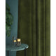 Curtain in a moss green velvet fabric with a stain resistant finish