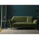 Dark green velvet sofa with a stain resistant finish