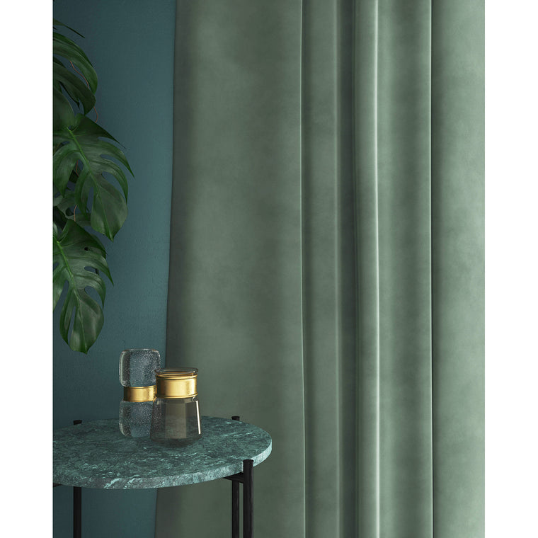 Curtains in a duck egg blue velvet fabric with a stain resistant finish