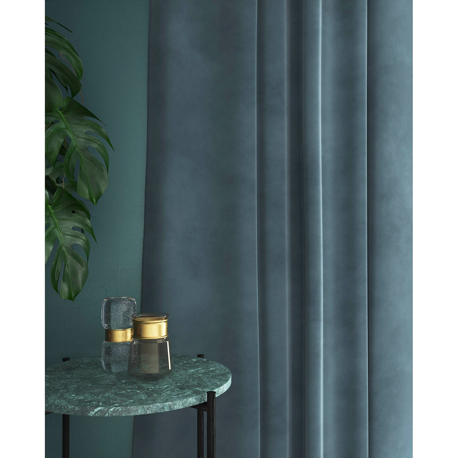 Curtains in a mid-blue plain velvet fabric with a stain resistant finish