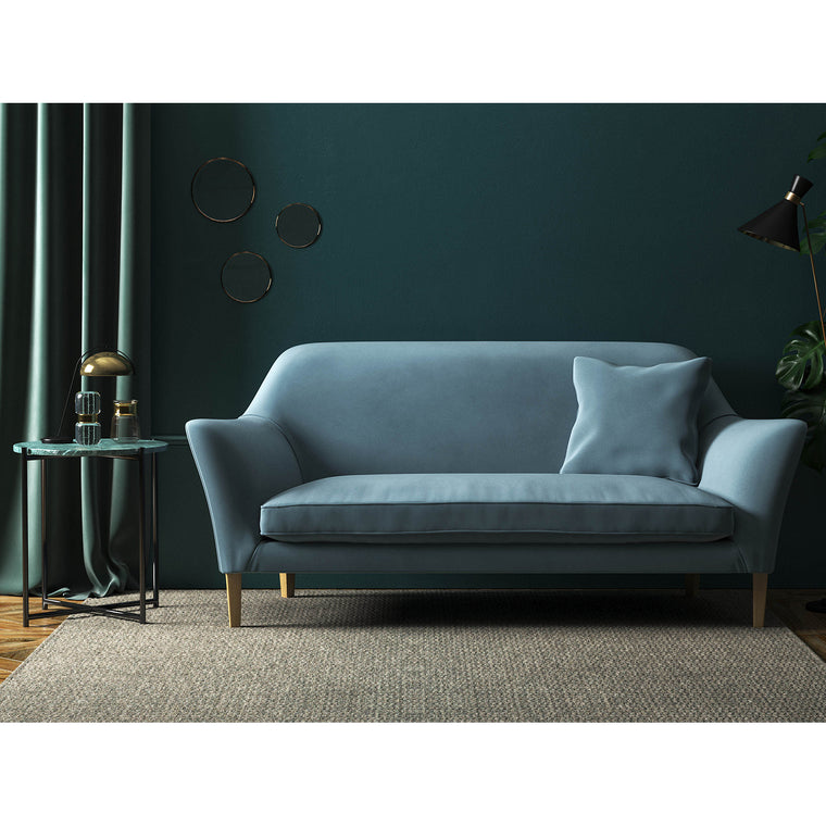 Sofa in a plain blue velvet upholstery fabric for contact and domestic use