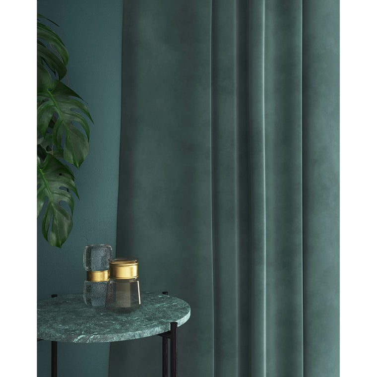 Curtains in a luxury teal plain velvet fabric with a stain resistant finish