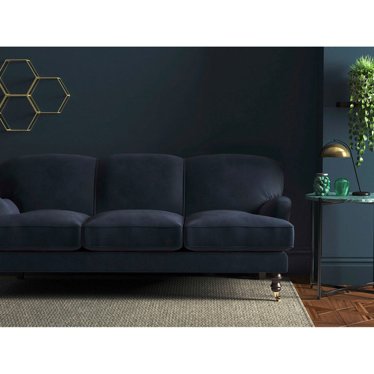 Sofa in a luxury dark blue plain velvet upholstery fabric for contract and domestic use