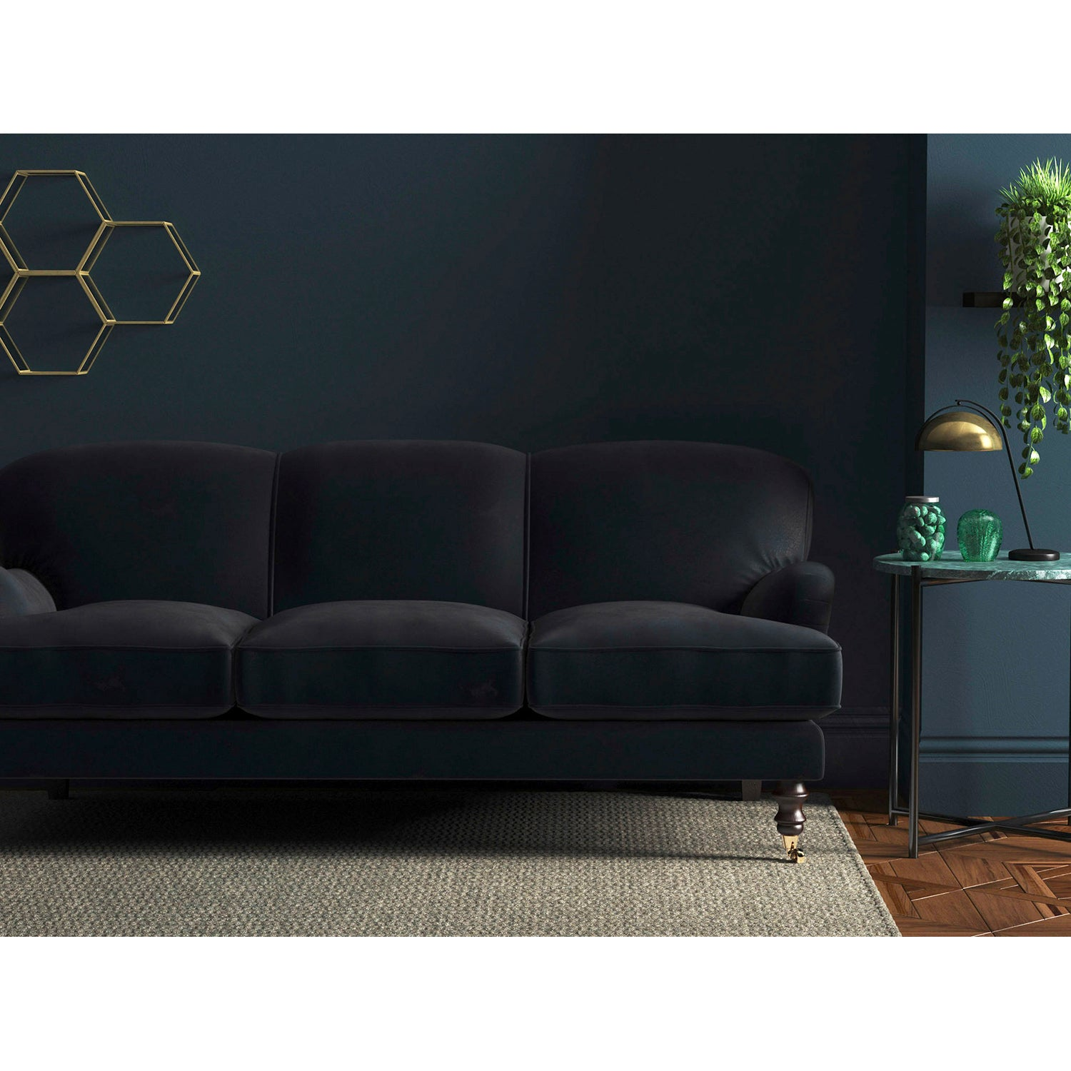 Navy velvet sofa with a stain resistant finish