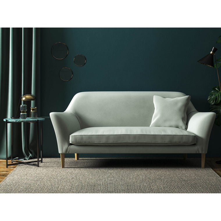 Light grey velvet sofa with a stain resistant finish