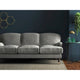 Sofa in a plain grey velvet upholstery fabric with a stain resistant finish