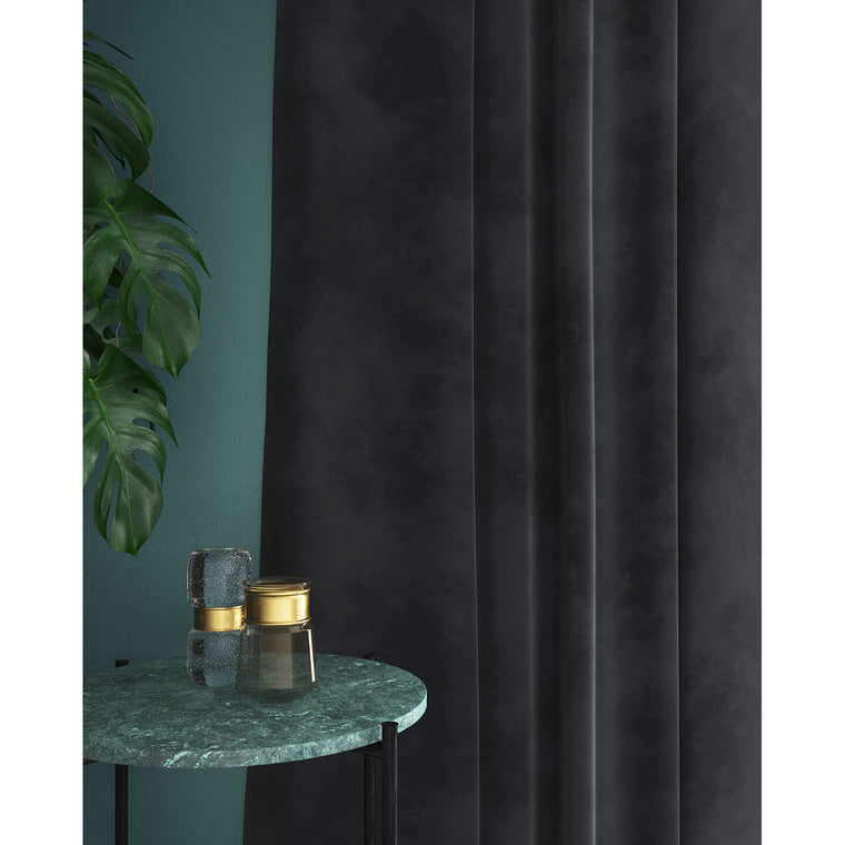 Curtain in a blue-toned grey plain velvet fabric with a stain resistant finish
