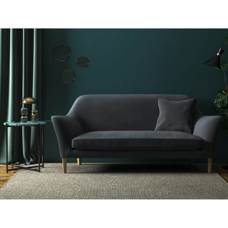 Sofa upholstered in a blue-toned grey plain velvet fabric with a stain resistant finish