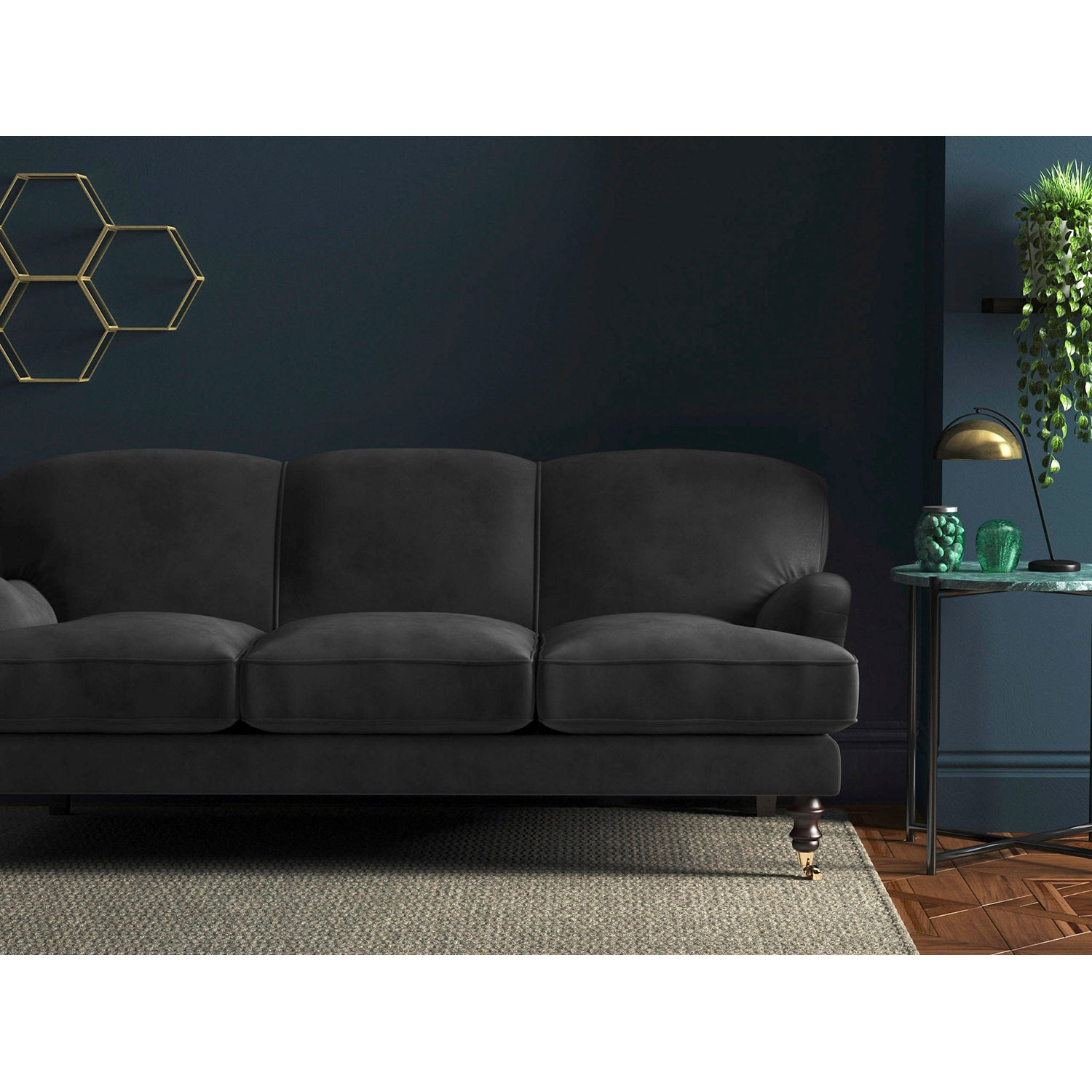 Sofa in a plain dark grey velvet upholstery fabric for domestic and contract use
