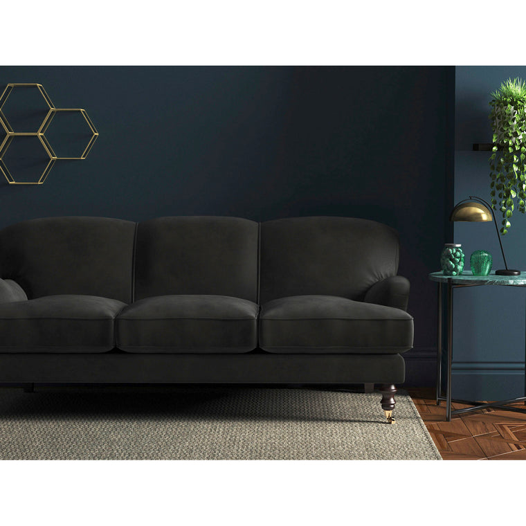 Dark grey velvet sofa with a stain resistant finish