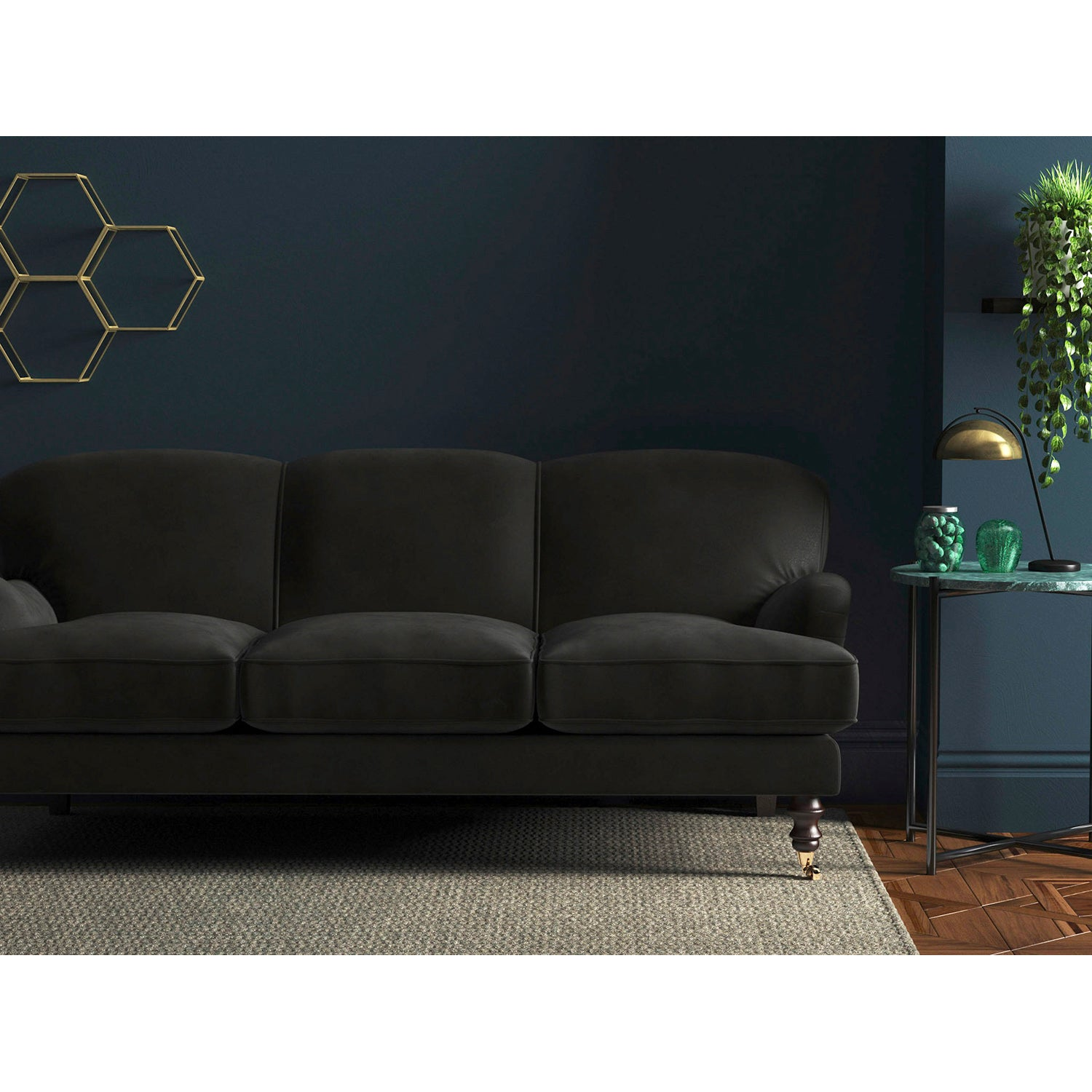 Sofa in a plain dark grey velvet upholstery fabric with a stain resistant finish