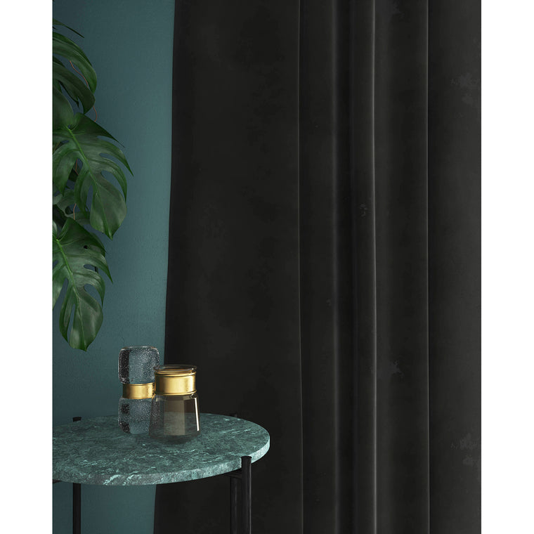 Curtain in a dark grey plain velvet fabric with a stain resistant finish