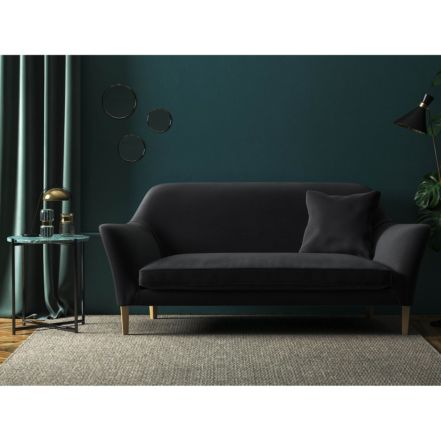 Sofa in a plain black luxury velvet fabric with a stain resistant finish