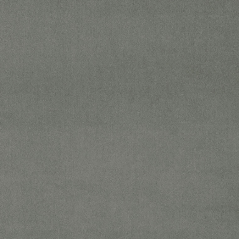 Swatch of a plain light grey velvet fabric for curtains and upholstery with a stain resistant finish