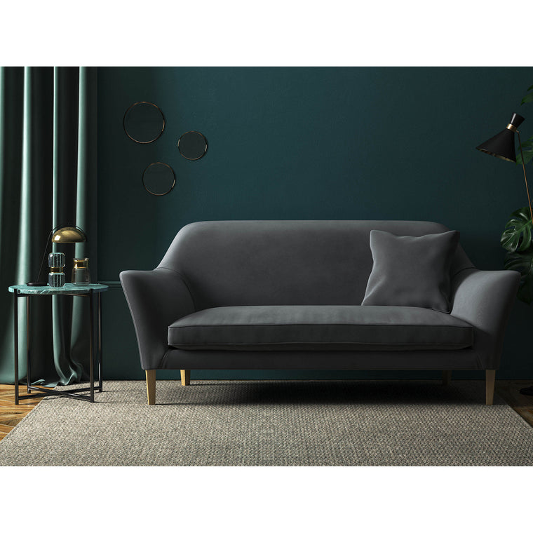 Grey velvet sofa with a stain resistant finish