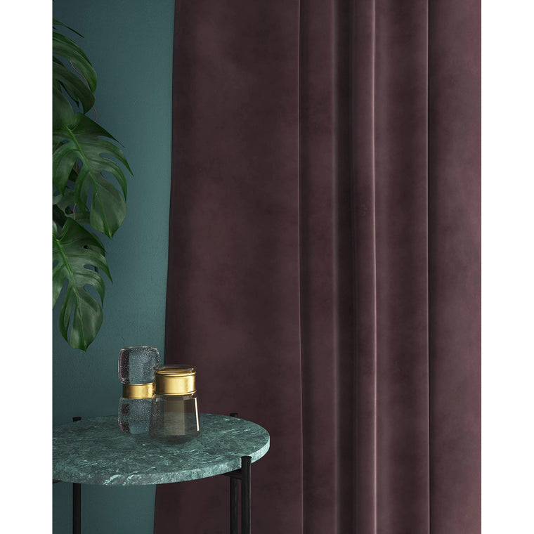 Curtain in a mauve plain velvet fabric for domestic and contract curtains