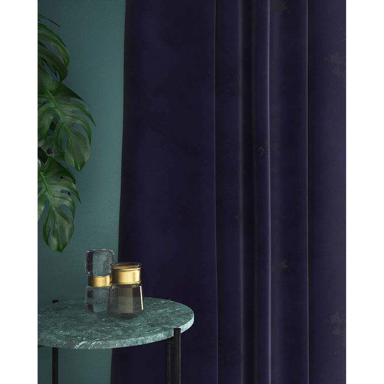 Curtain in a royal purple plain velvet fabric with a stain resistant finish