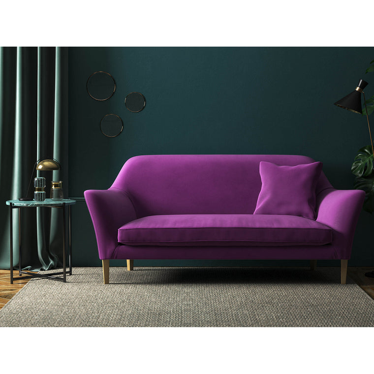 Sofa in a vibrant luxury purple velvet upholstery fabric with a stain resistant finish