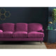 Purple velvet sofa with a stain resistant finish