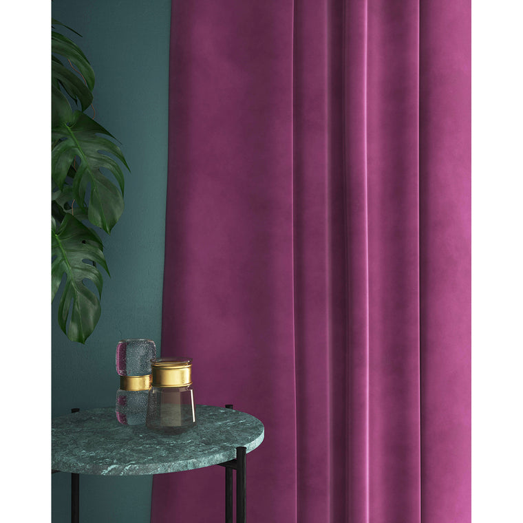 Curtain in a plain purple velvet fabric for contract and domestic use