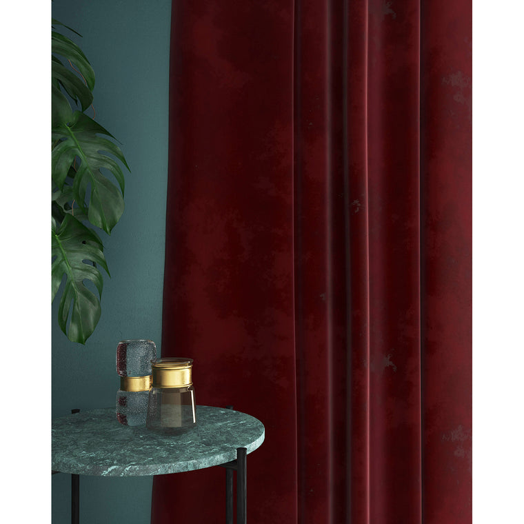 Dark red velvet curtains with a stain resistant finish