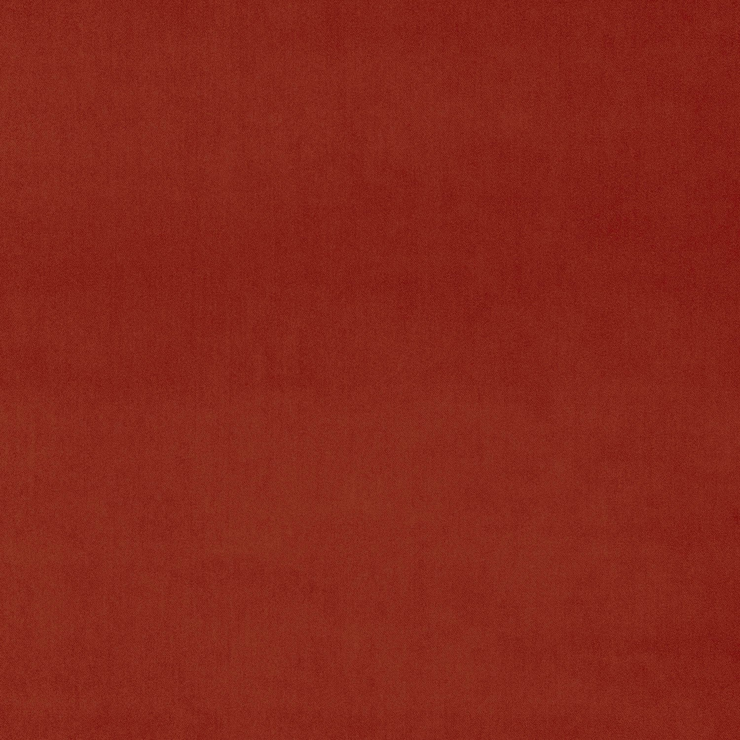 Luxury plain velvet fabric in a dark orange colour for curtains and upholstery