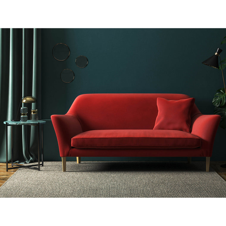 Sofa in a plain dark orange velvet fabric with a stain resistant finish