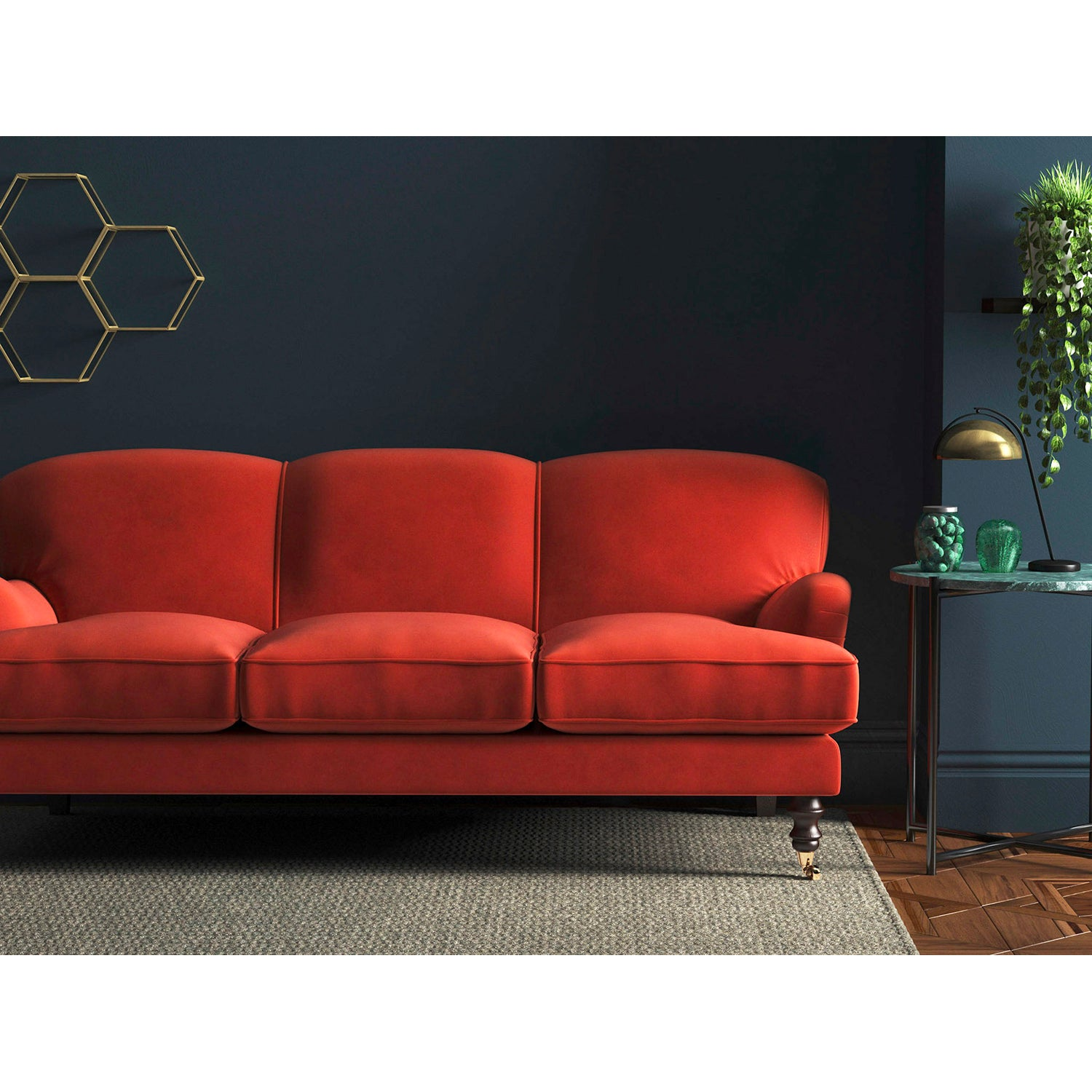 Sofa in a plain vibrant orange velvet upholstery fabric