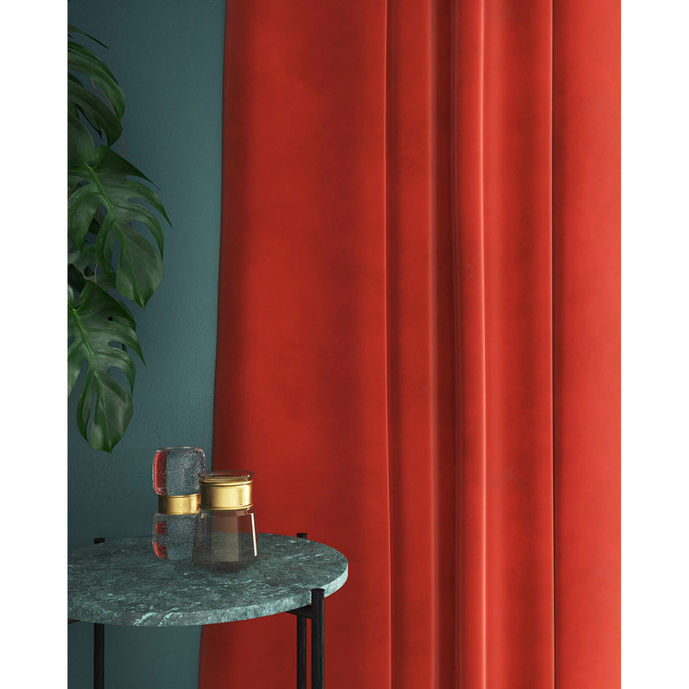 Curtain in a plain vibrant orange velvet fabric with stain resistant finish