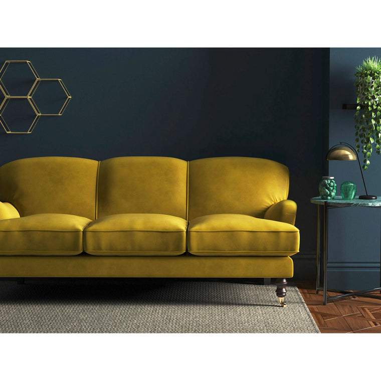Yellow velvet sofa with a stain resistant finish