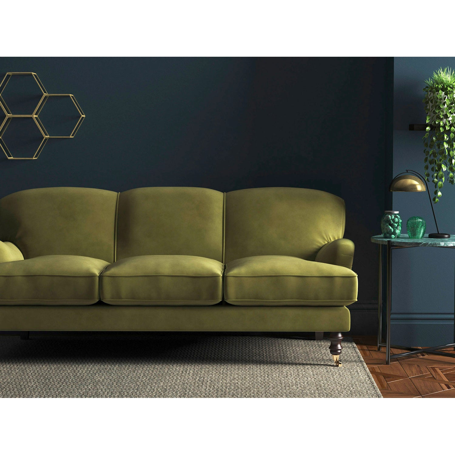 Green velvet sofa with a stain resistant finish