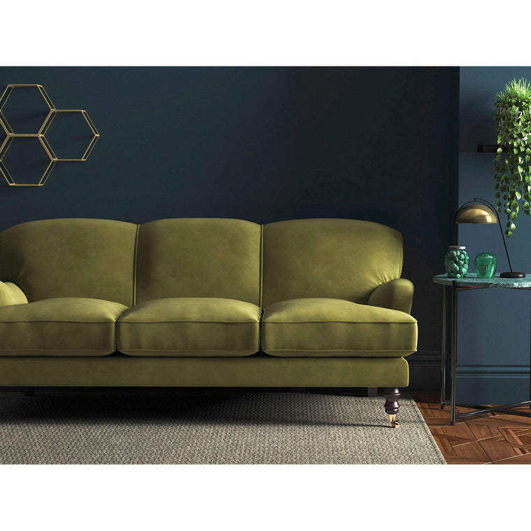 Sofa in a sage green stain resistant velvet upholstery fabric