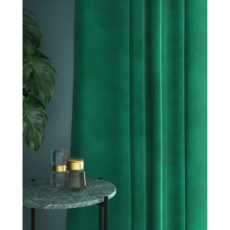 Curtain in an aqua green velvet fabric with a stain resistant finish