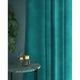Curtain in a turquoise velvet fabric with a stain resistant fabric